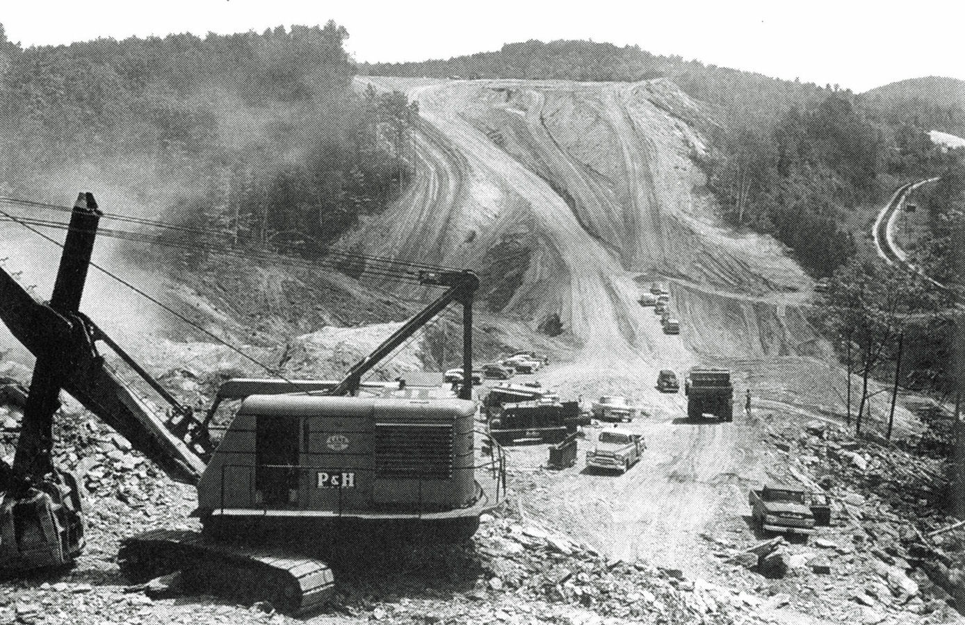 Historic photograph of a tractor in a construction zone.