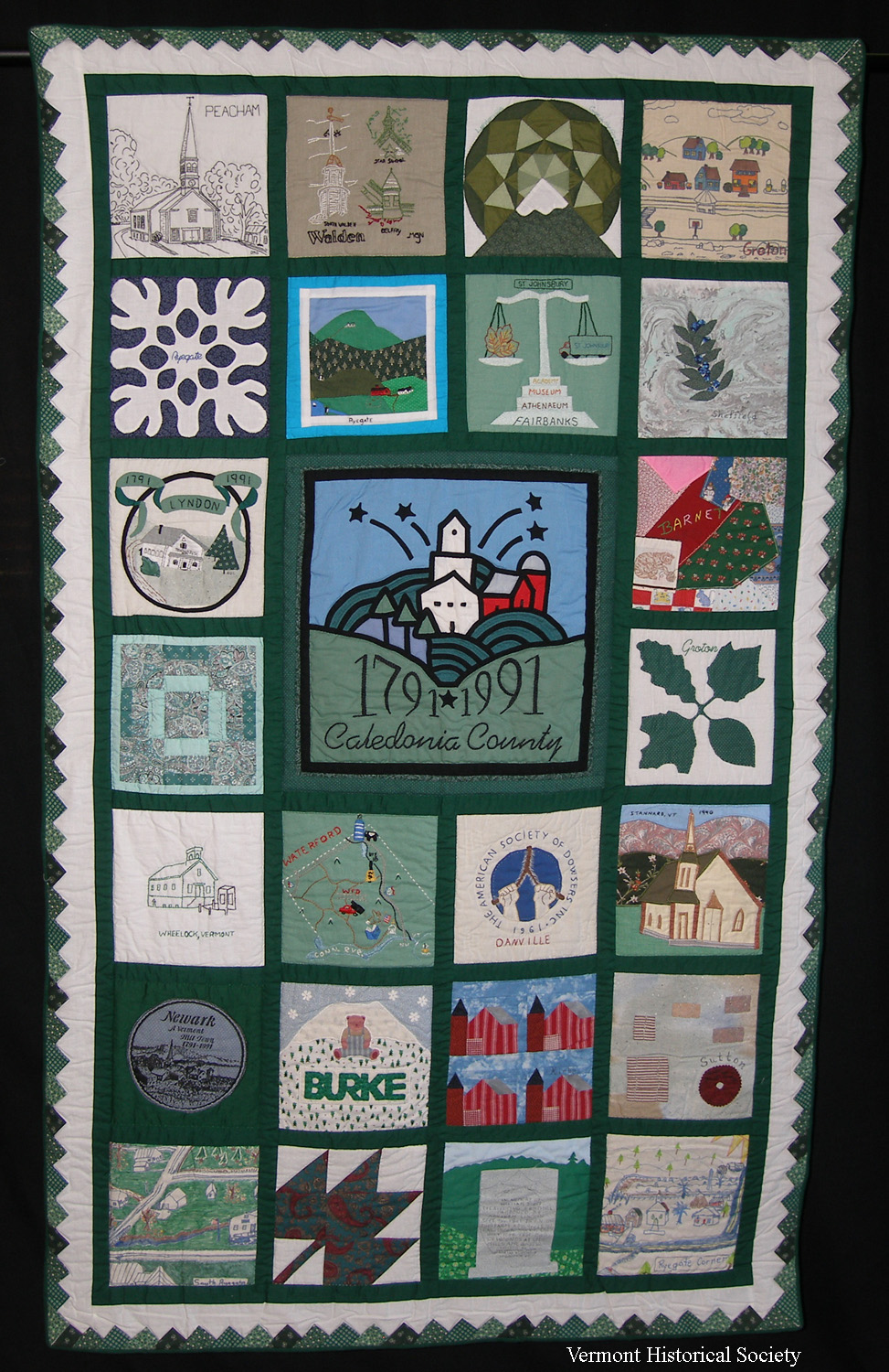 A patchwork quilt showing scenes from Vermont.