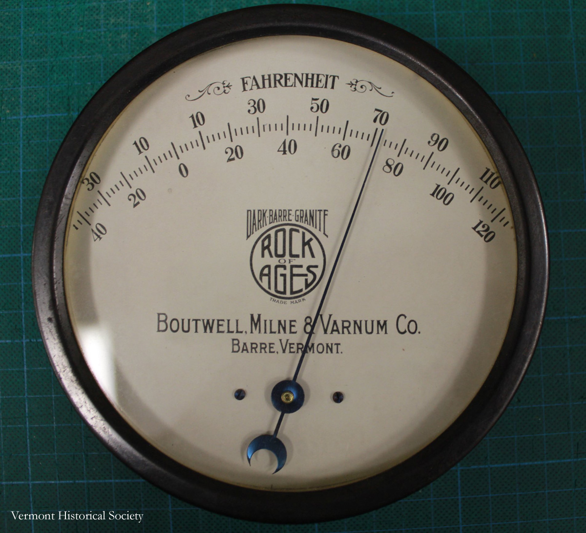 This thermometer was made around the end of the 19th century. On it are different logos for industries in Vermont.