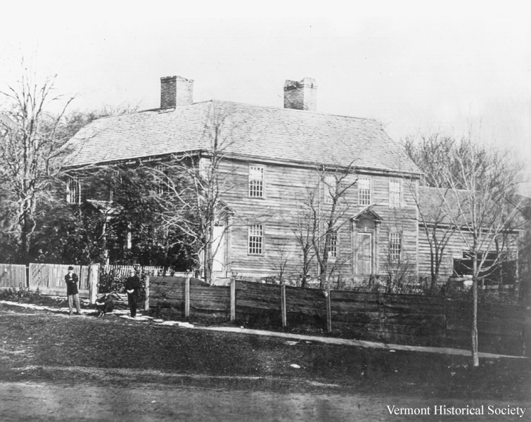 Historic photograph of Catamount Tavern, a large wooden building.