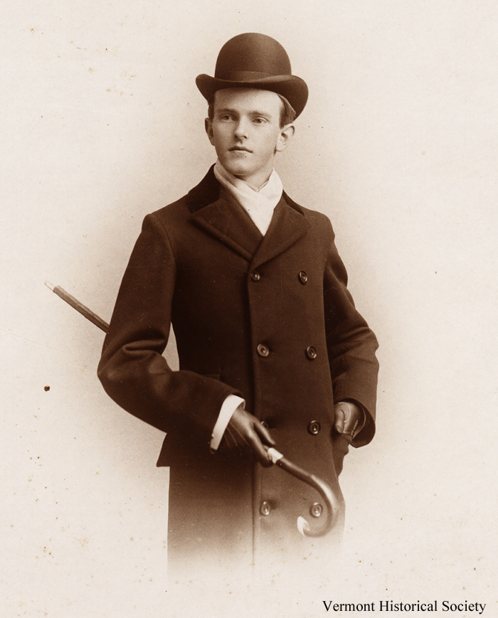Historic photograph of a young man in a hat and jacket.