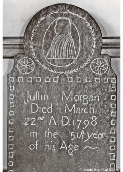 A photograph of a gravestone with writing.