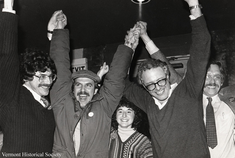 A picture of several people with their arms raised.